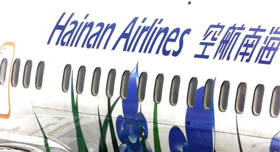 Et fly fra Hainan Airlines, som også skal udlåne fly til de nye ruter, Beijing Capital Airlines skal flyve mellem København og Danmark. (ELECTRONIC IMAGE) AFP PHOTO/GOH Chai Hin