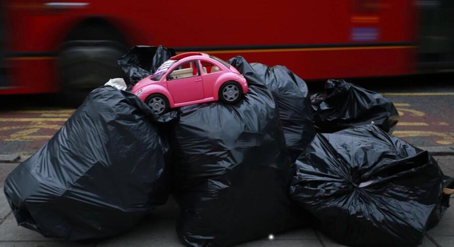 Volkswagen nedjsuterede tirsdag forventnigerne til 2015, efter at det er blevet besluttet at sætte 6,5 mia. euro - eller godt 48 mia. kr. - til side i sagen.