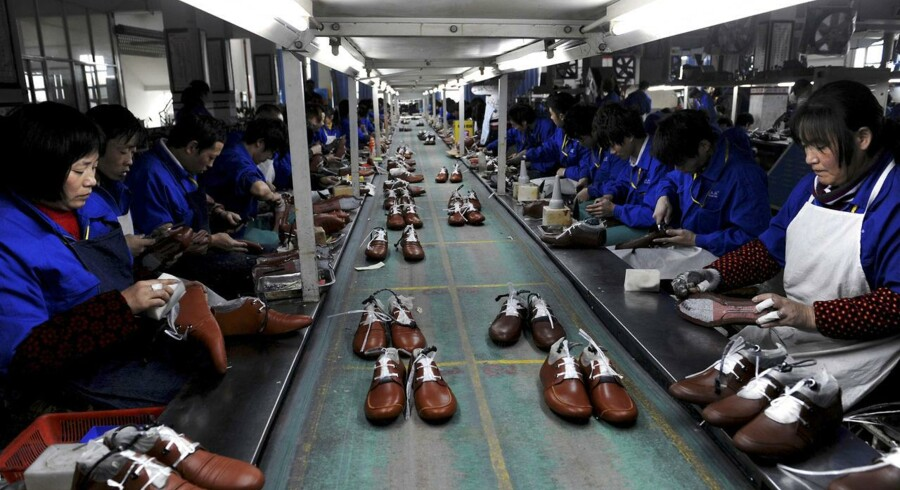Employees work at a shoe factory in Lishui, Zhejiang province, in this January 24, 2013 file photo.