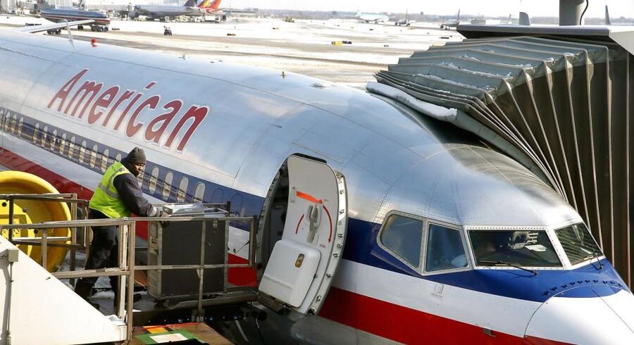 Fusionen mellem American Airlines og US Airways skaber verdens største flyselskab med omkring 6.700 flyvninger om dagen.