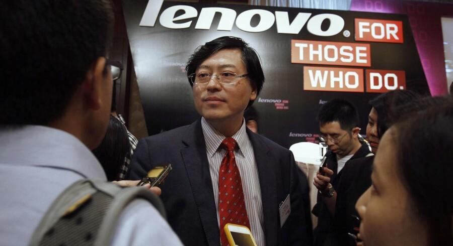 Lenovos topchef og bestyrelsesformand, Yang Yuanqing, kan være tilfreds med resultatet for årets første tre måneder, hvor hans virksomhed har tjent markant flere penge på et hårdt marked. Her ses han ved forelæggelsen af regnskabet torsdag. Foto: Bobby Yip, Reuters/Scanpix