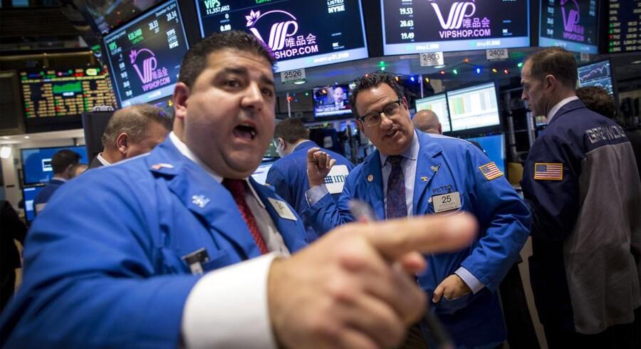 Historien giver ikke noget entydigt svar på, hvordan den forventede stramning af penge-politikken vil påvirke aktiemarkedet og andre finansielle markeder. Her er vi på børsen i New York.