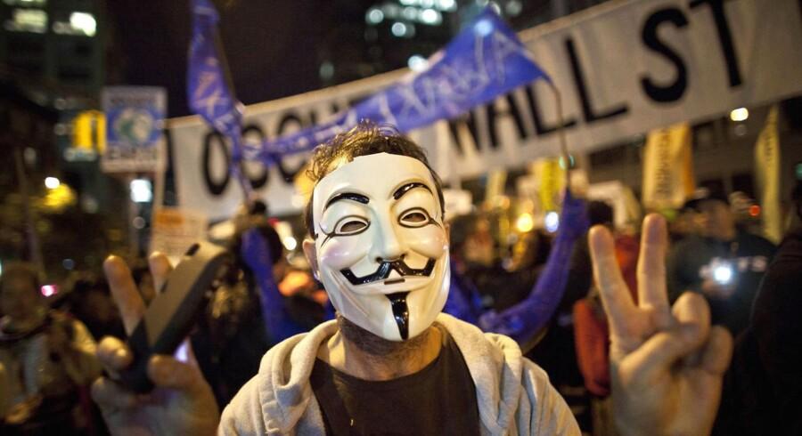 Et af symbolerne på Occupy-bevægelsen blev hurtigt de såkaldte Guy Fawkes masker.