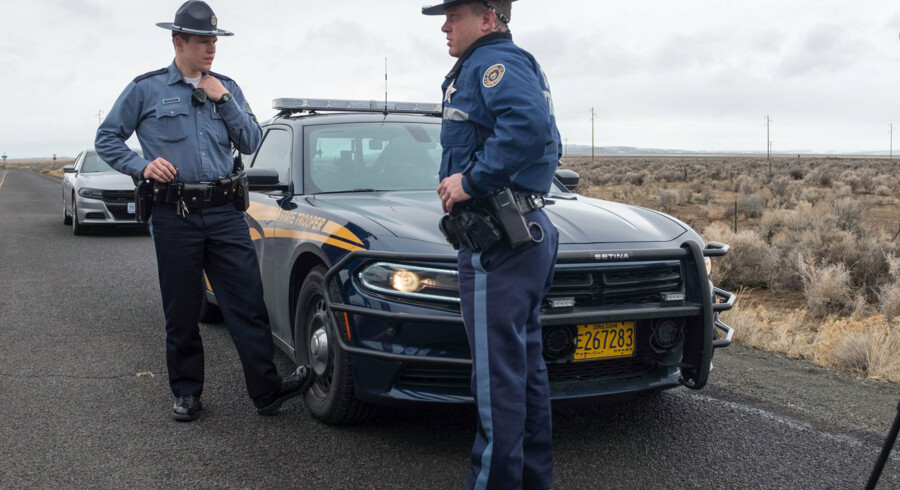 (FILES) This file photo taken on January 29, 2016 shows Oregon State Police monitor a checkpoint near the Malheur Wildlife Refuge near Burns, Oregon. The FBI on Wednesday surrounded the last four demonstrators holed up in a weeks-long armed siege at a federal wildlife refuge in Oregon, US authorities said. Negotiations between the occupiers and the FBI were ongoing and no shots had been fired, the Federal Bureau of Investigation said, on the 40th day of the standoff. / AFP / Rob Kerr / TO GO WITH AFP STORY BY Veronique DUPONT / XGTY