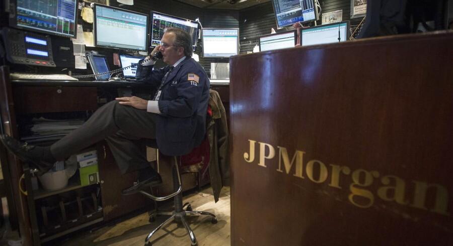 JPMorgan Chase & Co har indgået forlig med de amerikanske myndigheder om ansvaret for videresalg af dårlige lån i store pakker, som var en medvirkende årsag til finanskrisen.