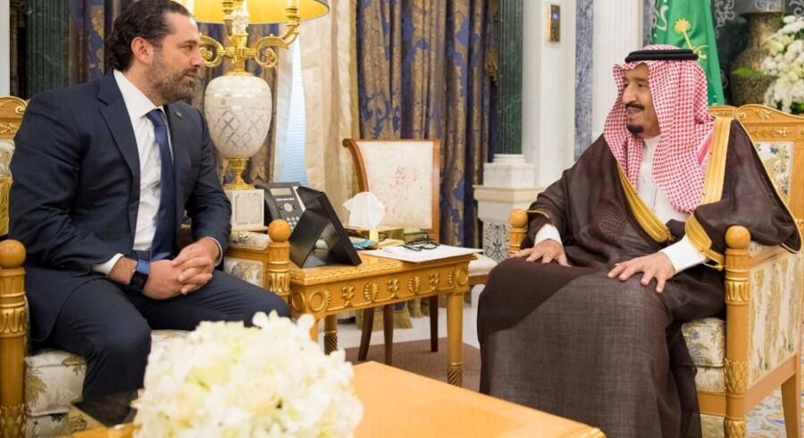 Libanons premierminister, Saad al-Hariri, som meddelte sin tilbagetræden fra Saudi-Arabien, tilbageholdes i landet, mener Libanons regering, som vil søge hjælp til at få ham hjem igen. Reuters/Handout