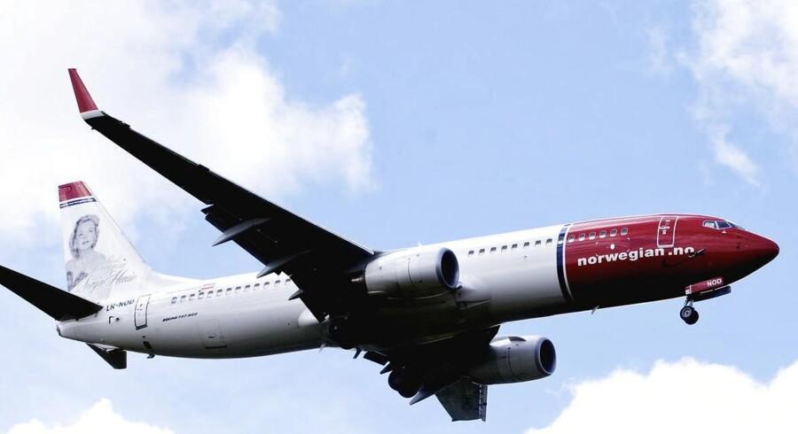 Det norske flyselskab Norwegian er under belejring fra investorer, der spår, at aktien vil falde i kurs. Arkivfoto.