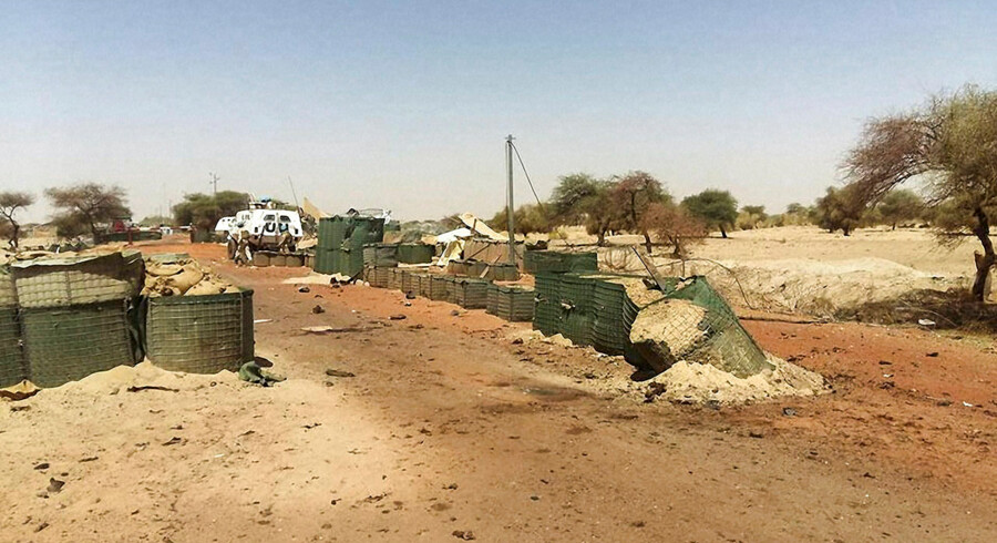 "A picture taken on April 16, 2018 shows the damages at the entrance of the International troops' ""Super Camp"" neighbouring Timbuktu's airport following April 14, 2016 four-hour rocket, mortar and car bomb attack. Around 15 militants have been killed in an attack on a United Nations base in northern Mali's historic city of Timbuktu, the French military told AFP on April 15, 2018. / AFP PHOTO / STRINGER"