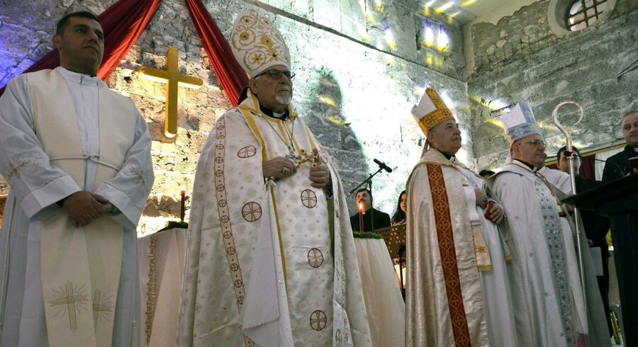 epa06404591 I år er den første julegudstjeneste, kristne har kunnet deltage i, siden Islamisk Stat erobrede byen i 2014. EPA/AMAR SALIH
