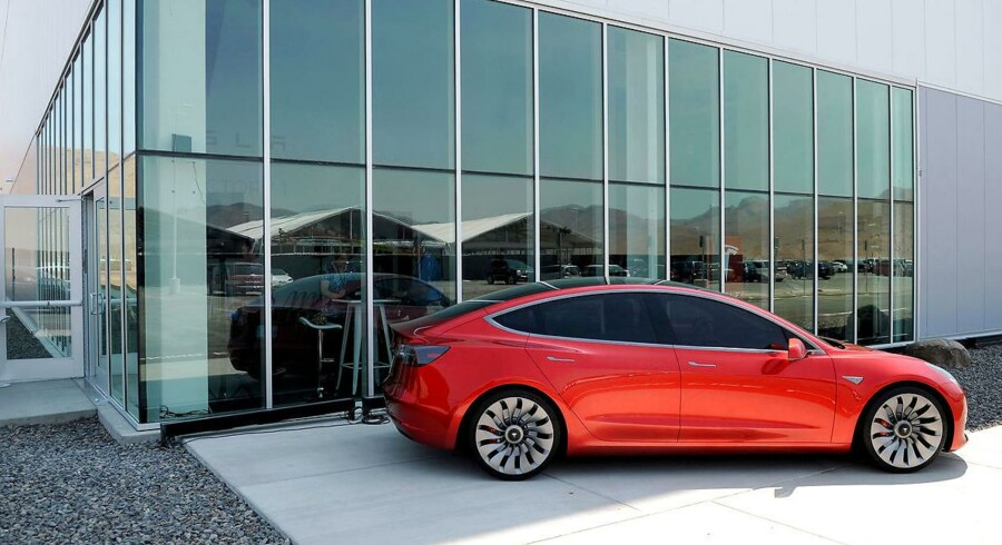A prototype of the Tesla Model 3 is on display in front of the factory during a media tour of the Tesla Gigafactory which will produce batteries for the electric carmaker in Sparks, Nevada on U.S. July 26, 2016. REUTERS/James Glover II/File Photo