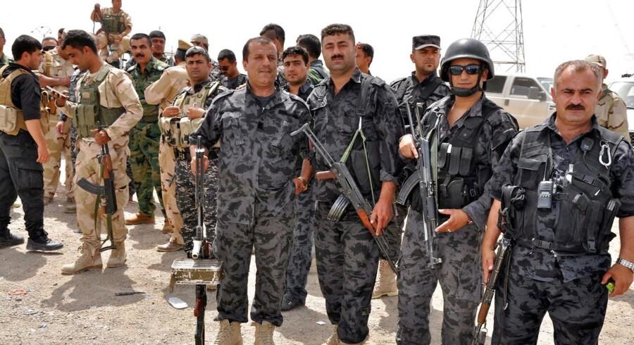 Styrker fra kurdernes egen hær, kaldet Peshmerga, i det nordlige Irak, er tirsdag rykket den nordirakiske landsby Basheer til undsætning, da byen blev angrebet af enheder fra den frygtede islamistiske gruppe, ISIS. Arkivfoto fra 12. juni 2014.