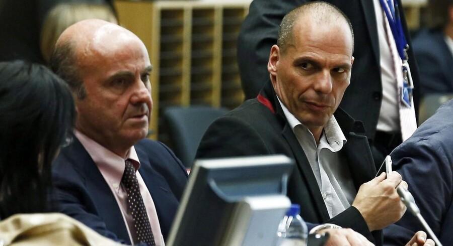 Den spanske finansminister Luis de Guindos (tv.) og den græske finansminister Yanis Varoufakis (R) ved onsdagens møde, der ikke bar frugt. Forhandlingerne genoptages torsdag.