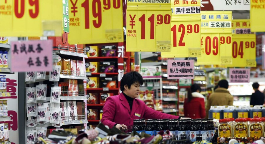 A sales assistant arrange products at a supermarket in Zouping, Shandong province, March 10, 2015. China's annual consumer inflation recovered in February, exceeding expectations, but producer prices continued to slide. REUTERS/China Daily (CHINA - Tags: BUSINESS POLITICS SOCIETY) CHINA OUT.NO COMMERCIAL OR EDITORIAL SALES IN CHINA