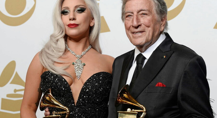epa04610999 Lady Gaga (L) and Tony Bennett (R) hold the awards for 'Best Traditional Pop Vocal Album' awards at the 57th annual Grammy Awards held at the Staples Center in Los Angeles, California, USA, 08 February 2015. EPA/PAUL BUCK