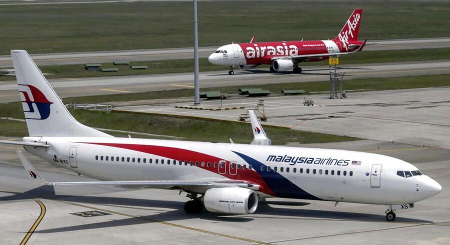 Passagererne aflyser i stor stil deres bookinger med Malaysian Airlines efter to flykatastrofer. Nu overvejer selskabet at skifte navn. Arkivfoto.