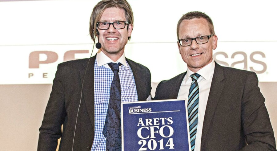 Berlingske Business Årets CFO 2014 i samarbejde med PFA Pension og SAS Institute. Årets CFO 2014: Heine Dalsgaard (th) CFO i ISS. Får overakt diplom af Peter Nordgaard fra Berlingske Media