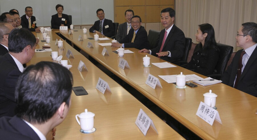 Hong Kong Chief Executive-elect C.Y. Leung (3rd R) meets with Hong Kong businessmen in Beijing on April 11, 2012. AFP PHOTO/Simon Song/POOL