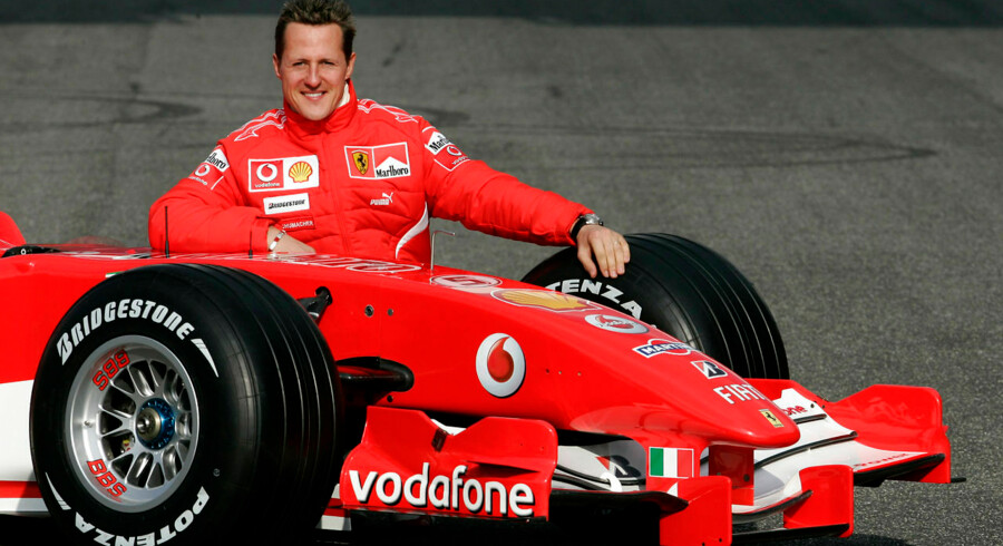 Michael Schumacher of Germany poses with the new Ferrari Formula One race car 248 F1 during the official presentation at the Mugello racetrack in Scarperia, central Italy, in this January 24, 2006 file photo. Formula One ex-champion Schumacher, who sustained severe head injuries in a ski accident in late 2013, is no longer in a coma and has left the French hospital where he was being treated since the accident, his spokeswoman said on June 16, 2014. REUTERS/Tony Gentile/Files (ITALY - Tags: SPORT MOTORSPORT F1)