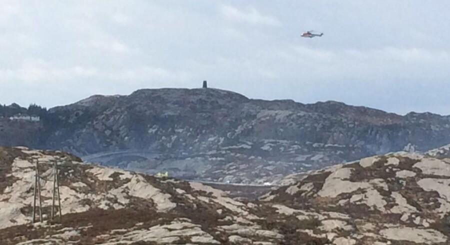 En helikopter har styrtet ved Turøy utenfor Bergen fredag ettermiddag, stor redningsaktion er i gang d. 29. april 2016. (Foto: Hommedal, Marit/Scanpix 2016)