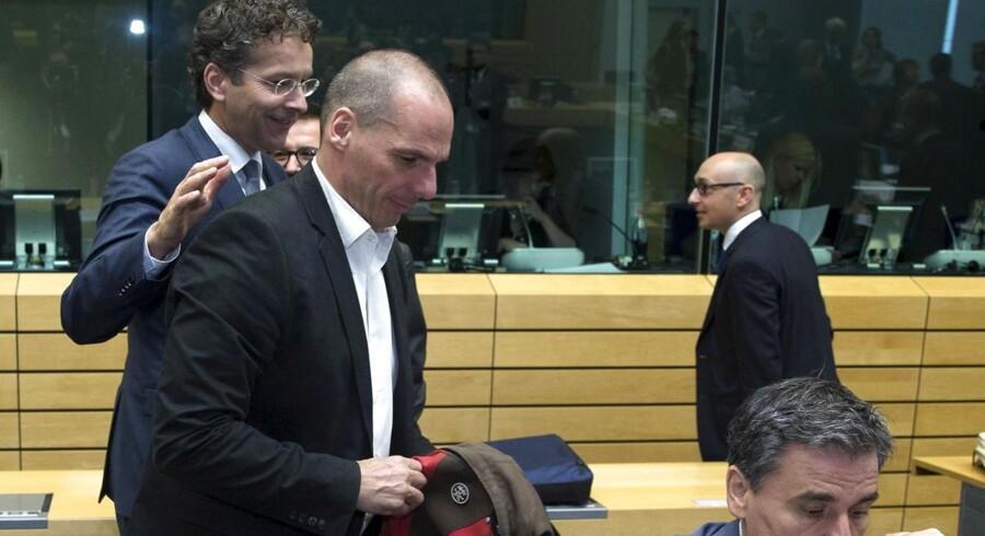 Et krisemøde blandt eurolandenes finansministre endte torsdag uden et kompromis om den græske gældskrise. Her er det Eurogruppens præsident Jeroen Dijsselbloem (tv.) og Grækenlands finansminister Yanis Varoufakis