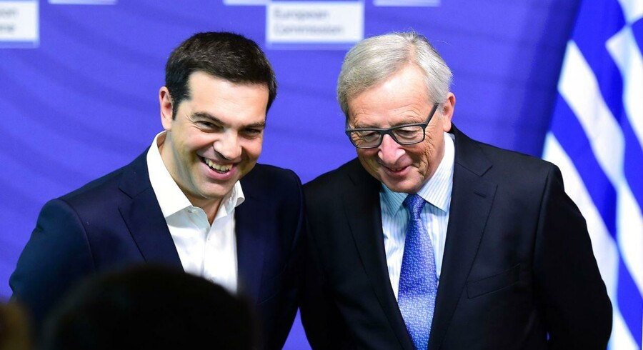 "Greece's Prime Minister Alexis Tsipras (L) is welcomed by European Commission President Jean-Claude Juncker ahead of an emergency eurozone summit on Greece at the European Commission in Brussels, on June 22, 2015. The European Central Bank (ECB) again increased emergency liquidity funds for Greece's banks on June 22, according to a Greek bank source who said the ECB may renew the hike ""at any time"" if necessary. AFP PHOTO / EMMANUEL DUNAND"
