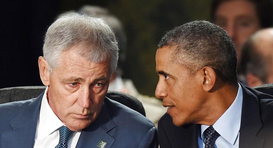 Forsvarsminister Chuck Hagel og præsident Barack Obama i et arkivbillede fra september 2014.