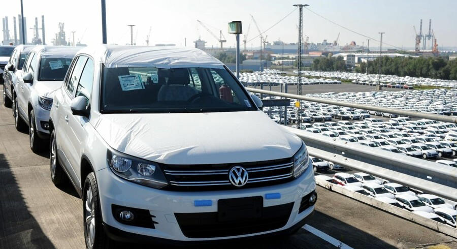 A new Volkswagen (VW) car is seen in the foreground as new cars of the Volkswagen group are parked ready for shipping at the car terminal of the port of Bremerhaven, northwestern Germany, on October 2, 2015. New car registrations in Germany, a key measure of demand in one of the most important sectors of Europe's top economy, rose in September, data showed, amid fears the Volkswagen pollution-cheating scandal could weigh on sales in the sector. AFP PHOTO / DPA / INGO WAGNER +++ GERMANY OUT +++