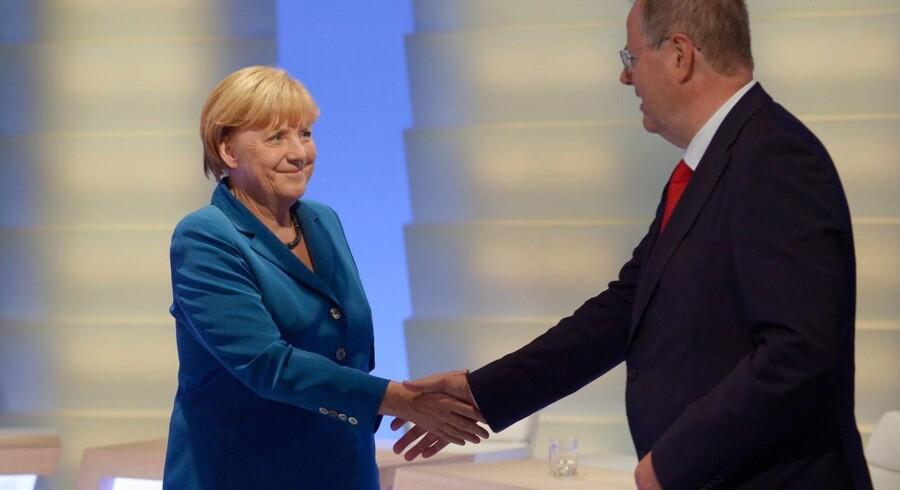 Angela Merkels CDU slog Peer Steinbrücks SPD, men sammensætningen af den nye Forbundsdag fordrer et samarbejde mellem de to partier.