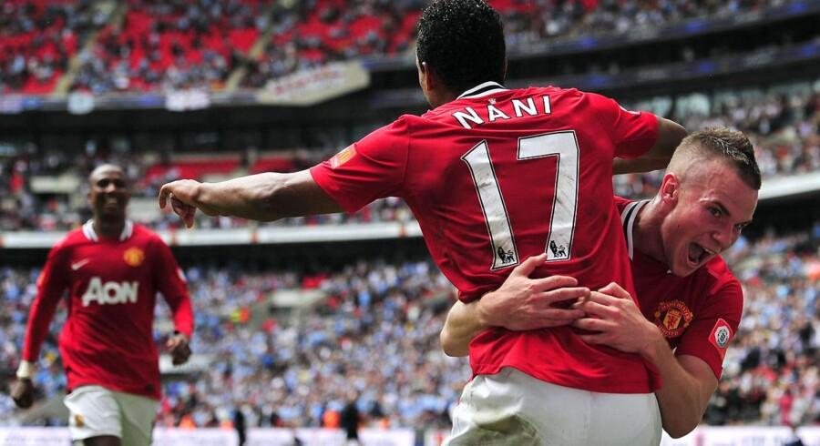 Manchester United-spillerne jubler over en scoring mod ærkerivalerne Manchester City i august. Men sidstnævnte klub har mest at glæde sig over, når det kommer til årets lønstigninger i Premier League.