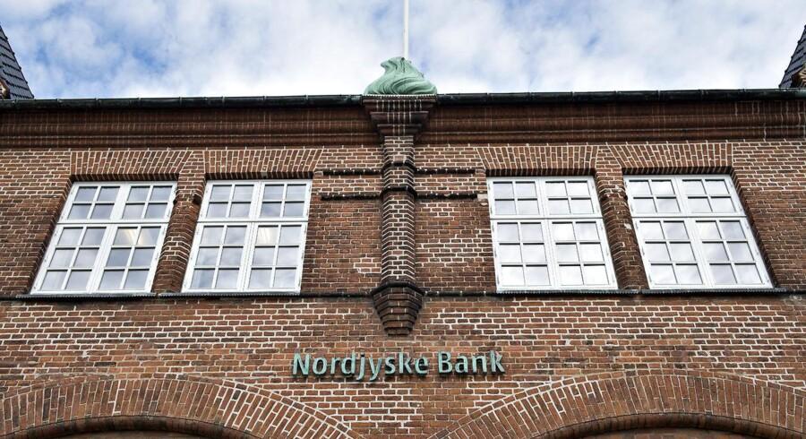 ARKIVFOTO. Nordjyske Bank meddeler sent torsdag, at banken har fremsat et købstilbud på alle aktier i Nørresundby Bank, der også har modtaget et bud på de resterende aktier fra sin hovedaktionær, Spar Nord. (se diverse Ritzau historier) Nordjyske Bank , hovedsæde, filial i Frederikshavn. Vil fusionere med Nørresundby Bank
