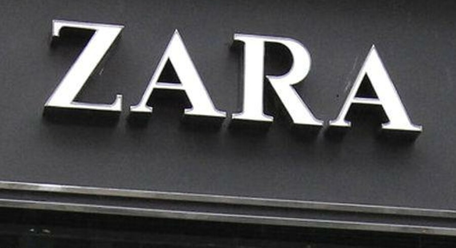 "A beggar stands in front of a shop window of a Zara store in central Madrid March 21, 2012. Spanish group Inditex, the world's leading clothes retailer, posted perky February sales figures on Wednesday and announced a 12.5 percent dividend rise as it aggressively expanded into fast-growing Asia. The cardboard reads ""I have 3 children, I'm hungry, I'm unemployed"". REUTERS/Andrea Comas (SPAIN - Tags: BUSINESS)"