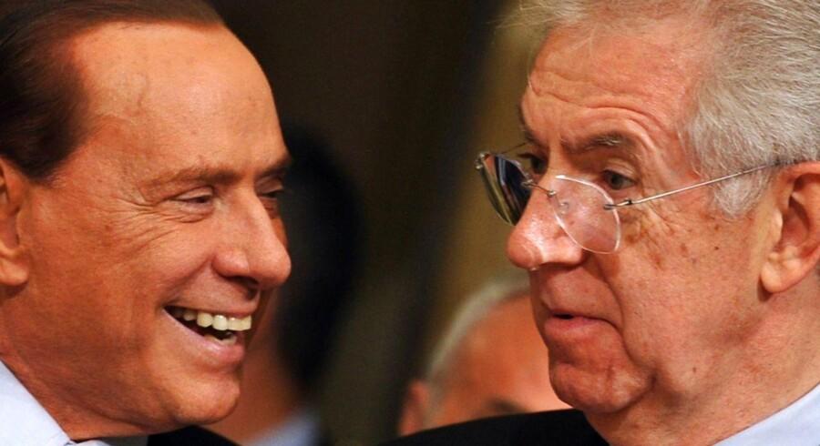 Mario Monti (til højre) får EU-roser for at have genskabt tilliden til Italiens økonomi efter Silvio Berlusconi.