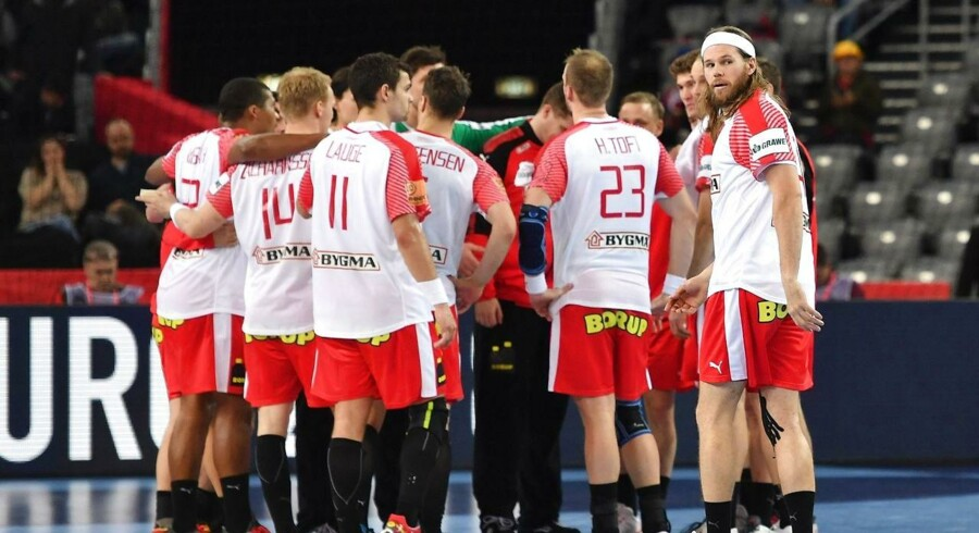 Denmark's Mikkel Hansen (R) looks at France's players (not in picture) after France won the match for third place of the Men's 2018 EHF European Handball Championship between France and Denmark on January 28, 2018 in Zagreb. / AFP PHOTO / Andrej ISAKOVIC