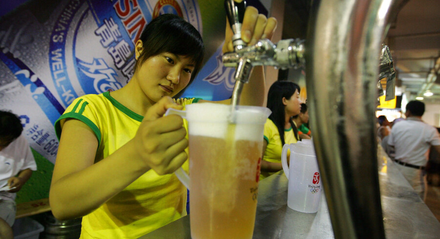 (FILES) In a file picture taken on August 24, 2007, a bartender fills a pitcher of beer at a beer garden in Qingdao, in eastern China's Shandong province, during the traditional Beer Festival month in the hometown of China's most famous beer, Tsingtao. China's biggest beer maker Tsingtao Brewery said on August 6, 2009, that first-half net profit rose 68 percent from a year earlier on higher sales volume. China overtook the United States as the world's top beer producer in 2002 and the Tsingtao Brewery is the country's oldest and most famous beer maker. AFP PHOTO/Frederic J. BROWN