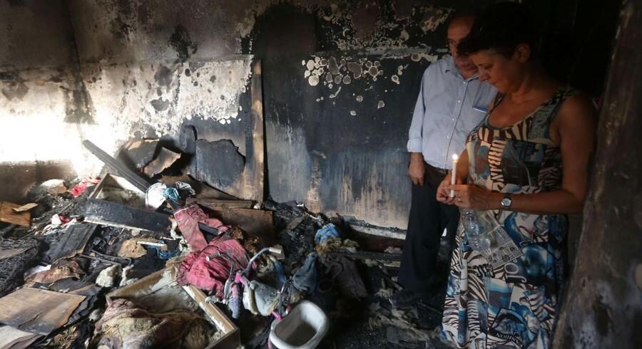I søndags, 2. august, døde etårige palæstinensiske Ali Dawabsheh i flammerne, da formodede ekstremistiske jøder udførte et brandattentat. Nu udspiller der sig en skarp debat internt blandt Israels jøder. Foto: Jaafar Ashtiyeh/AFP