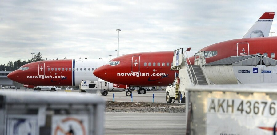 Aircrafts of Norwegian low-cost airline Norwegian Air Shuttle are parked at Arlanda airport in Stockholm, Sweden, on March 5, 2015, as pilots of the airline staged a strike. The Norwegian pilots, employed by its subsidiary Norwegian Air Norway, want to maintain tight organisational links with the parent company in the hope of safeguarding their jobs and to standardise salary conditions for all pilots employed in the various Scandinavian subsidiaries. AFP PHOTO / TT NEWS AGENCY / JOHAN NILSSON +++ SWEDEN OUT +++