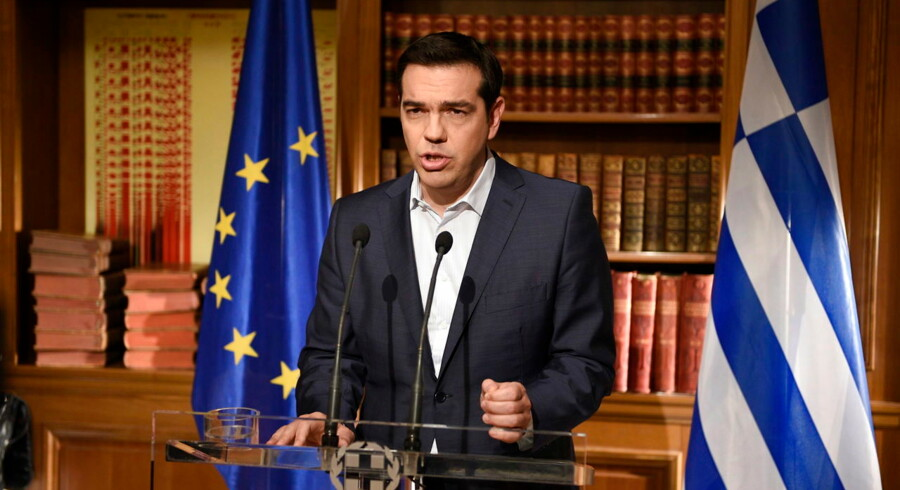 epa04827011 A handout picture released by the Greek Prime Minister's press office on 01 July 2015 of Greek Prime Minister Alexis Tsipras addressing the nation about the referendum on 05 July 2015, during a speech broadcasted from his office in Athens, Greece, 01 July 2015. Tsipras remained steadfast in his controversial plan to hold a referendum on the bailout demands of creditors, as eurozone finance ministers discussed a request from Athens for new financial aid. During the televized address to the nation Tsipras said that anyone equating a no-vote with a return to the drachma is 'telling lies, ' and repeated his call for people to vote against the measures. EPA/ANDREA BONETTI/PRIME MINISTER OF GREECE PRESS OFFICE/HANDOUT HANDOUT EDITORIAL USE ONLY/NO SALES