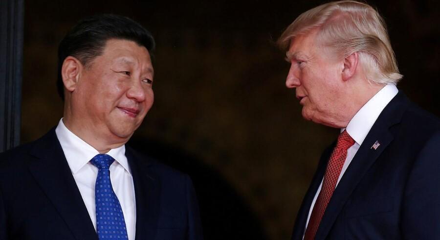ARKIVFOTO: Donald Trump med besøg af Kinas præsident, Xi Jinping, sidste år. USA er i handelskrig med Kina, og den amerikanske præsident beskylder nu Kina for at manipulere med valuta og renter.