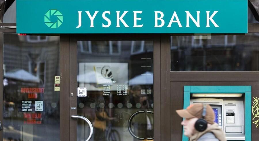 Jyske bank offentliggjorde 2013-regnskabet mandag aften og fortalte samtidigt, at banken overtager BRFkredit.