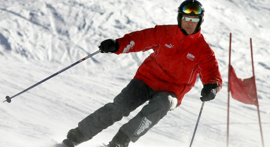 "(FILES) This file picture taken on January 14, 2005 shows German Ferrari driver Michael Schumacher skiing during a slalom race in the winter resort of Madonna di Campiglio, in the Dolomites area, northern Italy. Michael Schumacher is ""showing small signs of progress"", his spokeswoman said on April 13, 2014, with the Formula One legend slowly recovering from devastating brain injuries suffered in a ski accident. AFP PHOTO / Patrick HERTZOG"