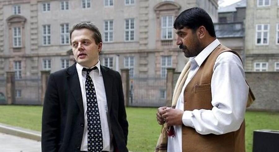 ARKIVFOTO. Ghousoullah Tarin sammen med sin advokat Tyge Trier foran Østre Landsret i København i 2011.