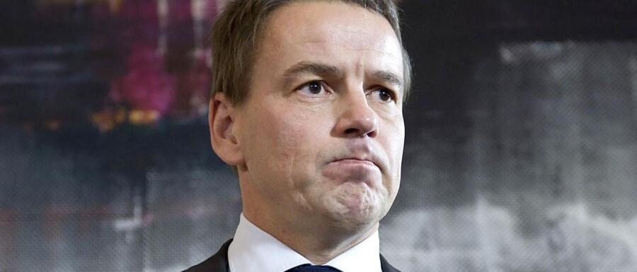 Forhenværende udviklingsminister Christian Friis Bach (R) tog sin afgang som udviklingsminister - her på et pressemøde torsdag d.21.november 2013 - efter at være blevet forkert informeret om GGGI's rejseregler, som han udtalte sig om til pressen efterfølgende.