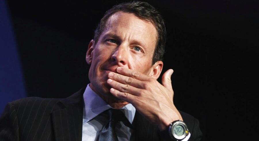 Arkivfoto. Lance Armstrong er blevet tiltalt for at have kørt væk fra et uheld, som han var i skyld uden at indrapportere det, og for at overskride hastighedsgrænsen.