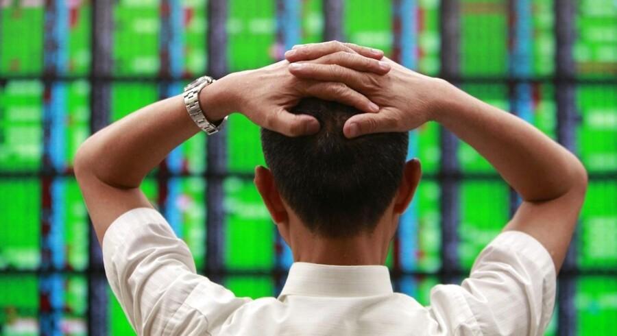 Investorerne kan ånde lettede op efter de amerikanske politikere er blevet enige om en budgetaftale. Effekten af aftalen kan mærkes globalt. Her et billede fra børsen i Taipei, Taiwan.