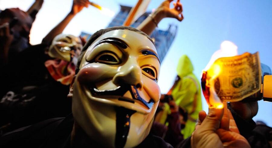 Demonstranter fra Occupy-bevægelser gør oprør mod de´t finansielle system i USA, som filmen 'Inside Job' beskriver.