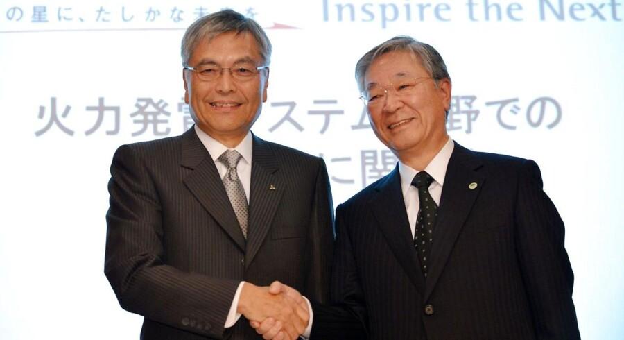 Præsident for Mitsubishi Heavy Industries, Hideaki Omiya (tv) (ved en pressekonference med Hitachi-præsident Hiroaki Nakanishi i Tokyo d. 29. november 2012) udtaler at man har samtaler med Vestas.