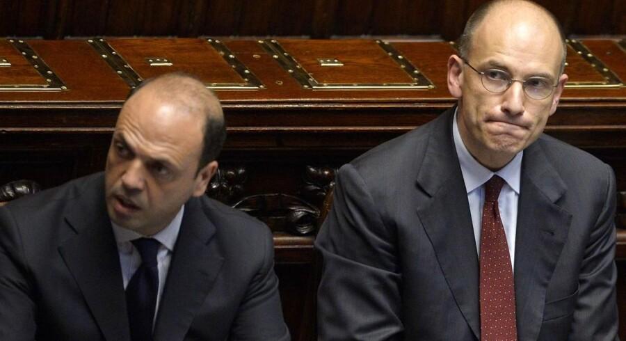 ARKIVFOTO. Italiens vicepremierminister Angelino Alfano (tv) og premierminister Enrico Letta (th).