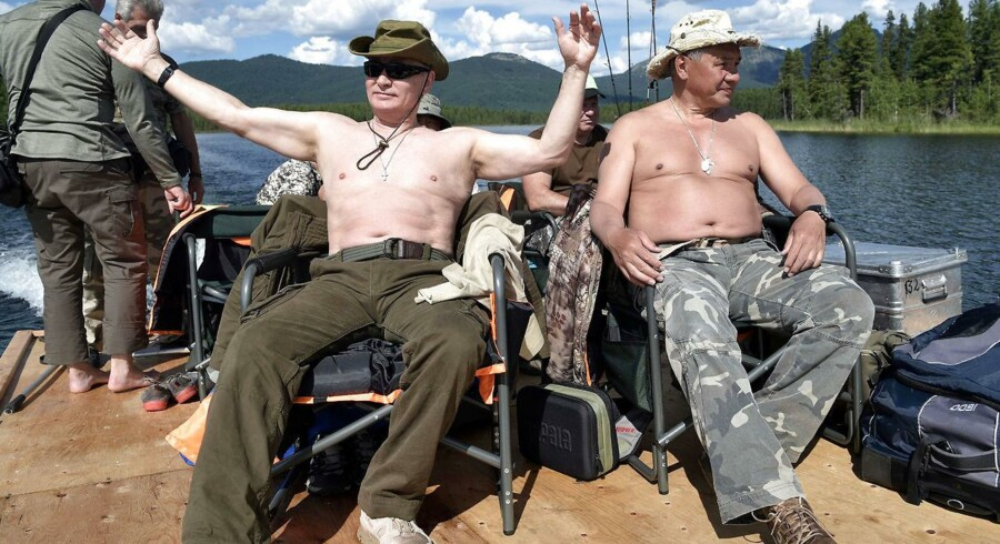 Russian President Vladimir Putin and Defence Minister Sergei Shoigu rest after fishing during the hunting and fishing trip which took place on August 1-3 in the republic of Tyva in southern Siberia, Russia, in this photo released by the Kremlin on August 5, 2017. Sputnik/Alexei Nikolsky/Kremlin via REUTERS ATTENTION EDITORS - THIS IMAGE WAS PROVIDED BY A THIRD PARTY.