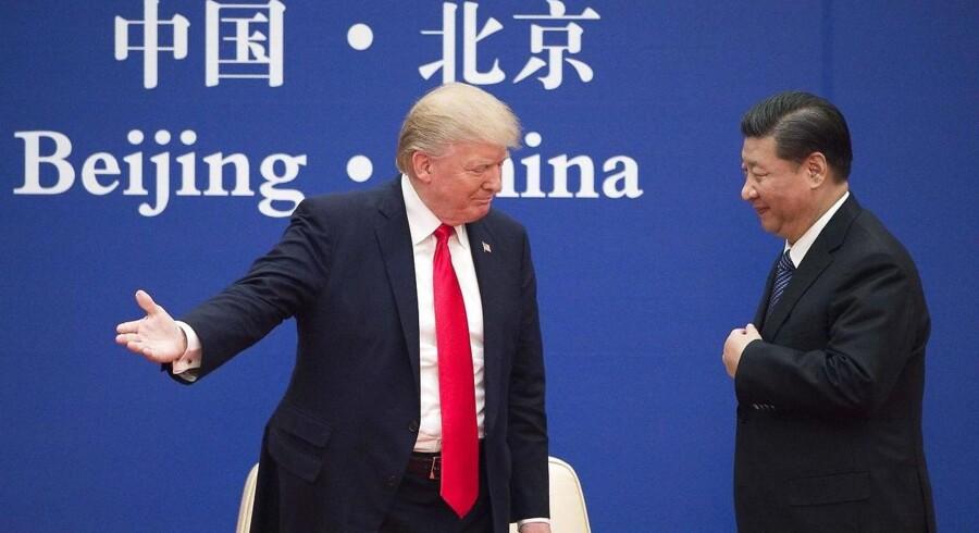 Donald Trump og Xi Jinping holder fælles pressemøde i Beijing.