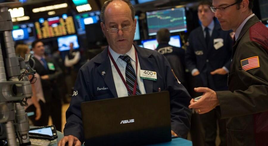 Arkivfoto. De amerikanske aktiebørser lukkede fredag tæt på uændret, men dog med et marginalt plus på 0,1 pct. til Dow Jones-indekset, som dermed nåede det højeste slutniveau nogensinde på 21.384,28.